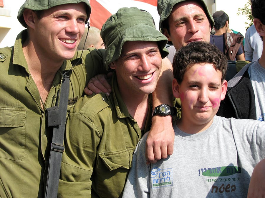 High School Students Bring Purim Cheer to IDF Soldiers Through LIBI